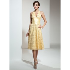 A-Line/Princess Halter Knee-Length Lace Bridesmaid Dress With Ruffle